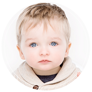Blond haird boy with blue eyes in portrait photo shoot Glasgow