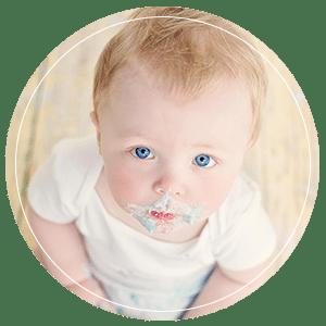 Baby boy eating birthday cake during cake smash photo shoot Glasgow