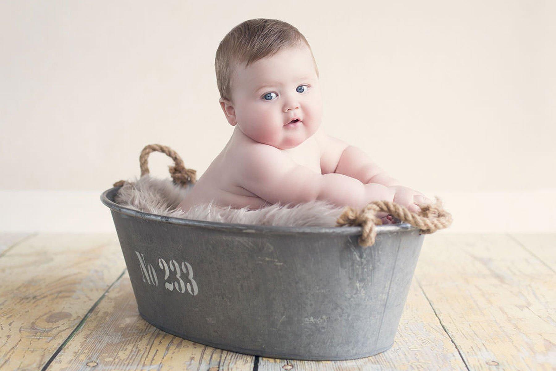 Baby boy in tin bath