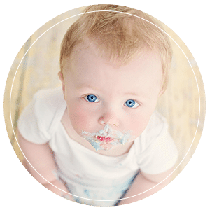Baby boy eating birthday cake during cake smash photo shoot Glasgow